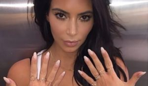 """I cannot wait to get my nails off. I feel like I just can't function in the real world with long nails."" –Kim Kardashian"